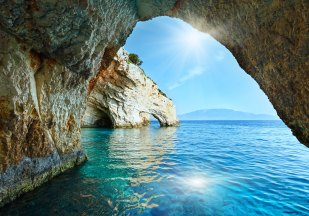 Sunshine in Blue Cave arch view from boat (Zakynthos, Greece, Cape Skinari )