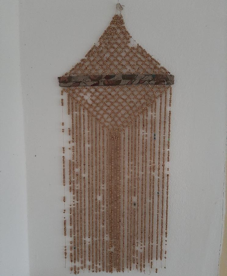 Dekoracija iš liūdesio sėklų